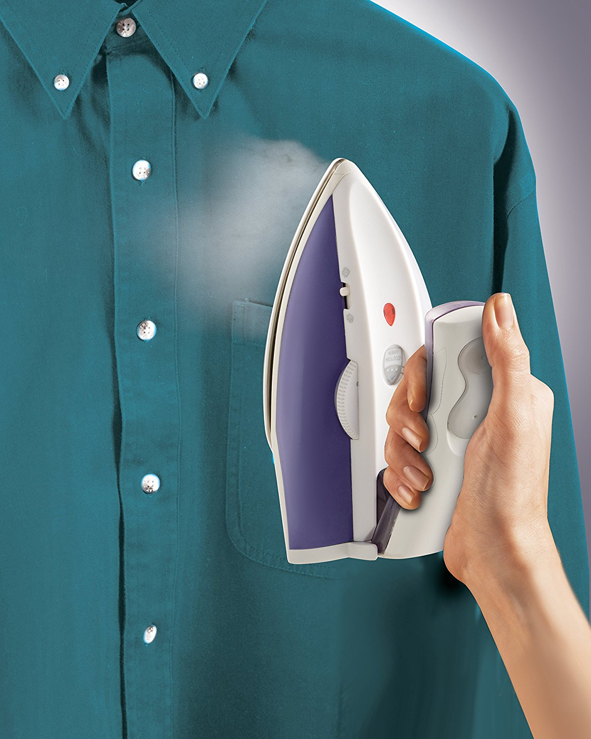 Image of Hamilton Travel Iron Steaming a Shirt