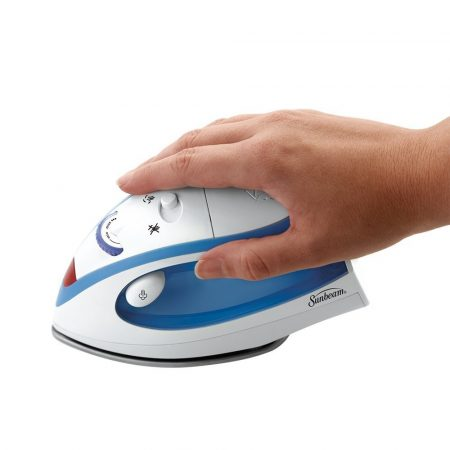 Image of Sunbeam Hot-2-Trot Compact Travel Iron underneath palm