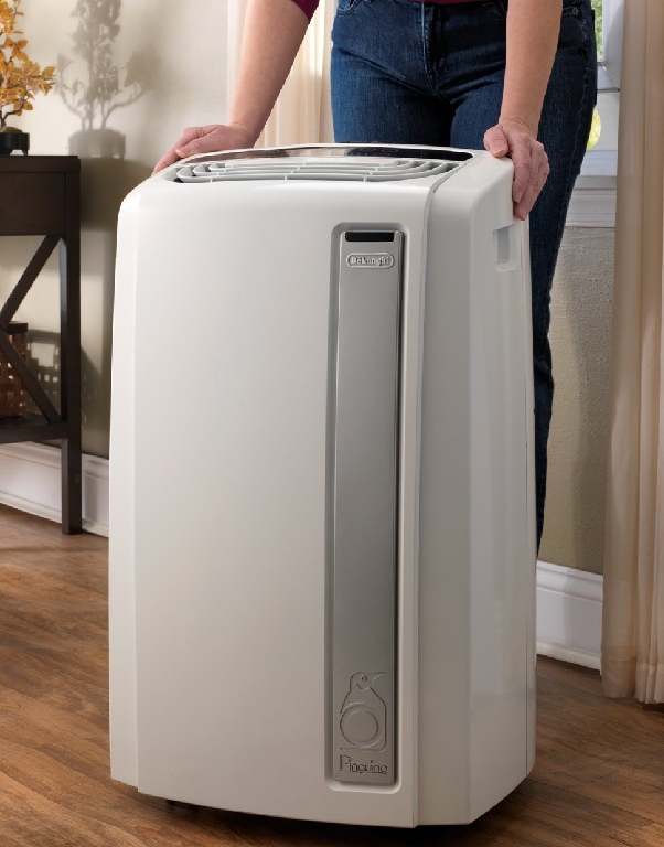 Picture of lady next to an air conditioner