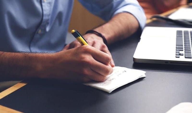 Man writing down a list