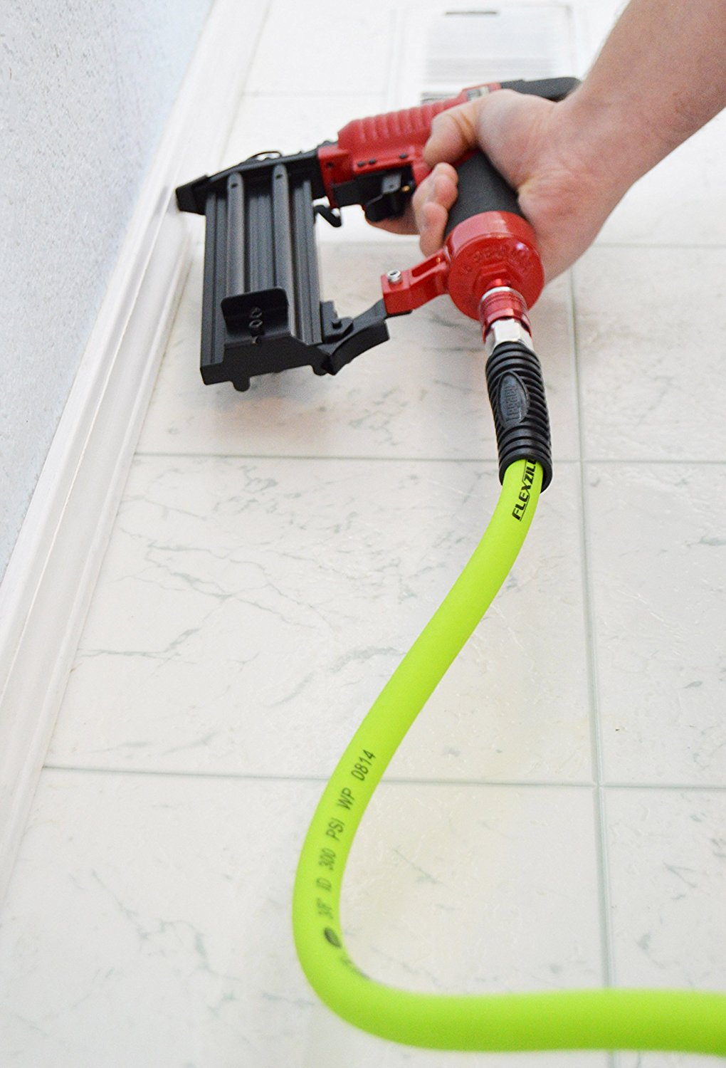 Action shot of Flexzilla hybrid air hose being used with nail gun