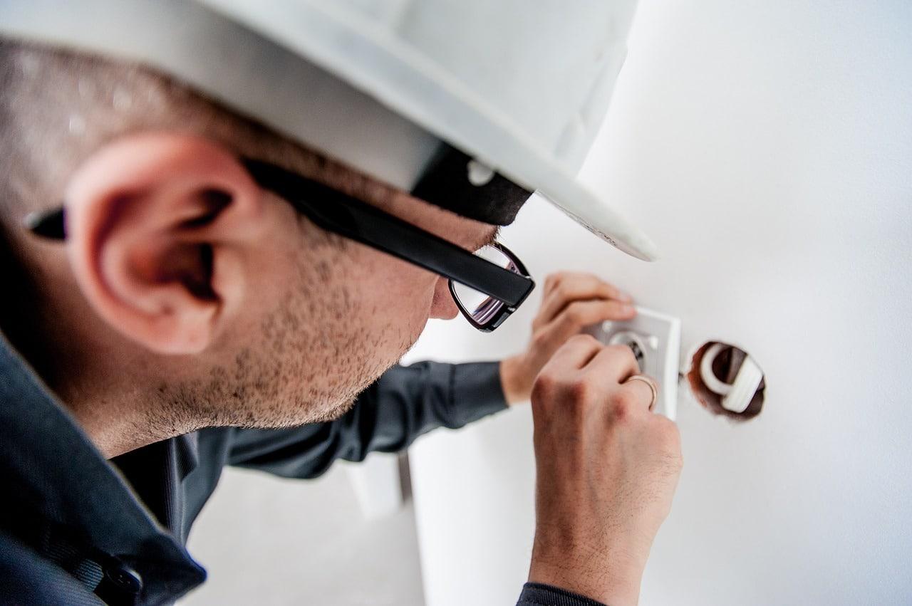 An electrician fixing a socket