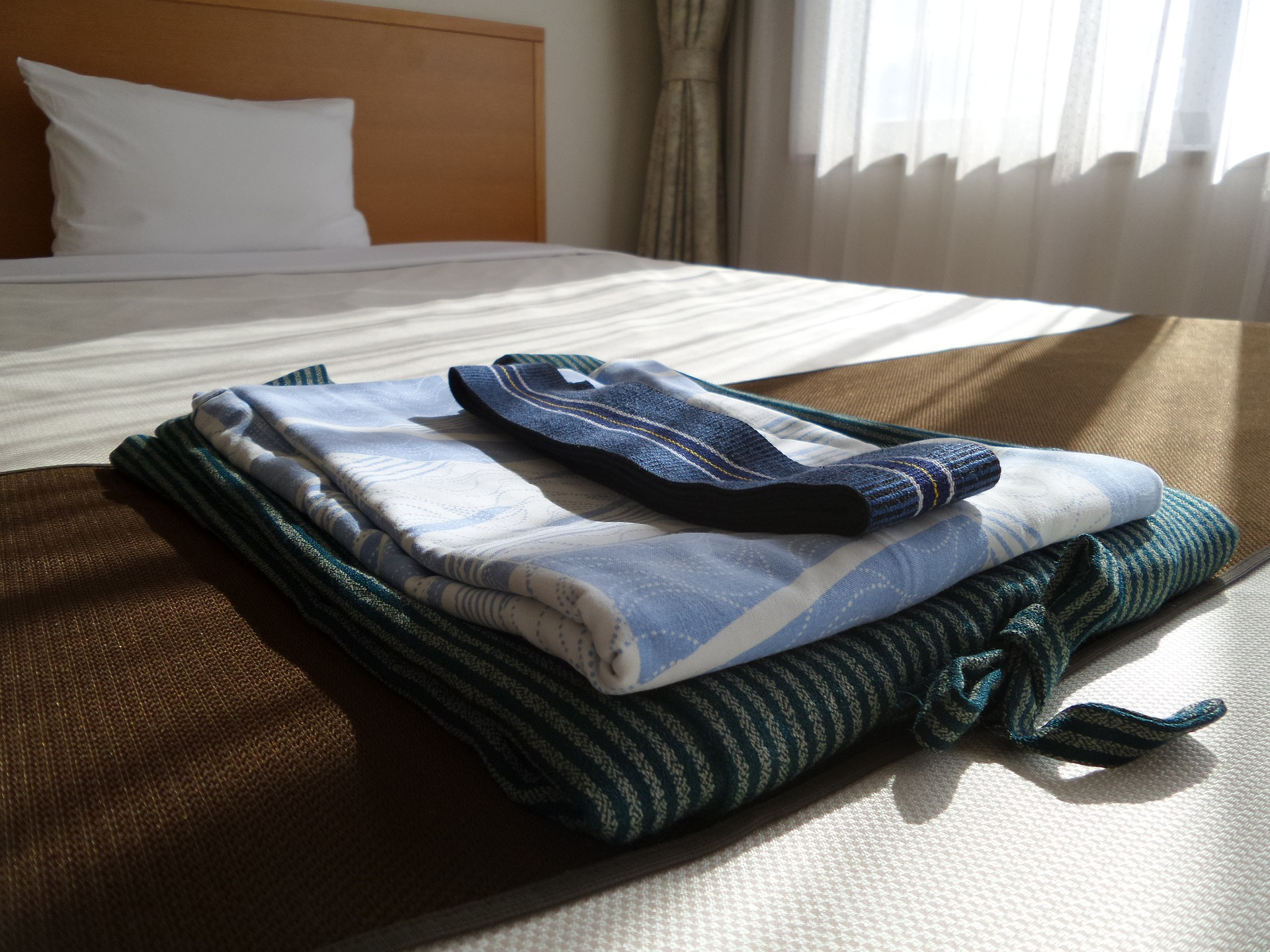 Folded clothes on a bed