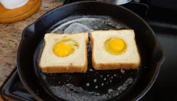Picture of cast iron skillet cooking egg on toast