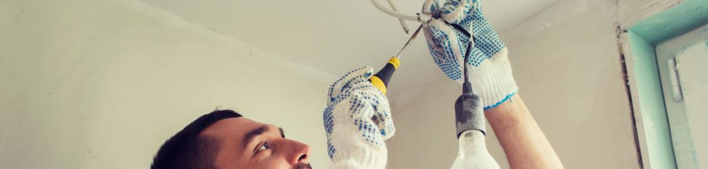 Electrician Changing Light Fixture
