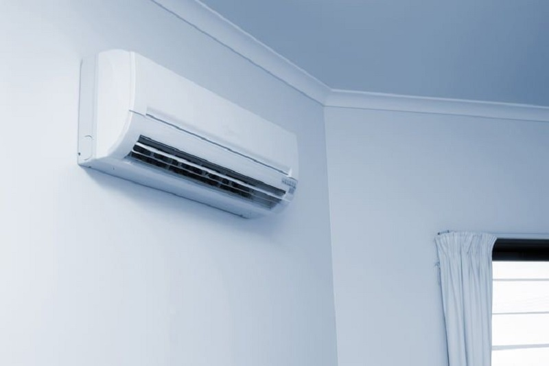 A typical wall air conditioner attached to a wall.
