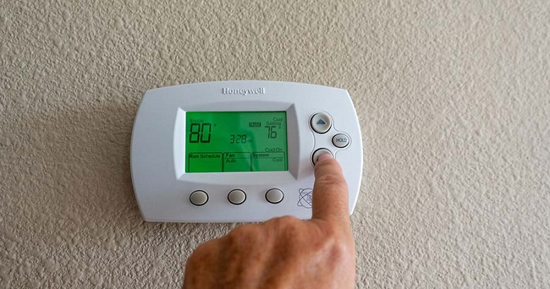 Turning on a Honeywell thermostat.