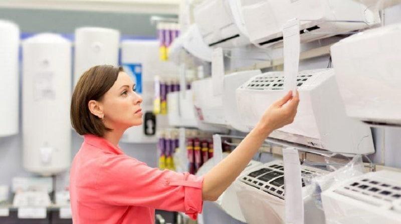 A woman choosing an air conditioner
