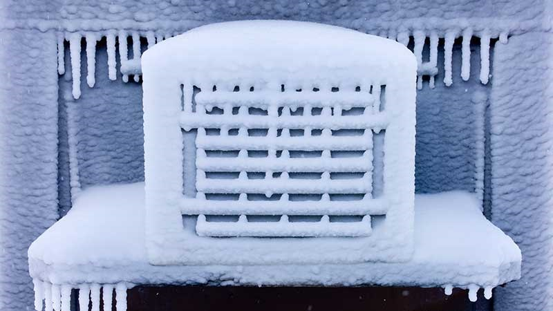 The outside of an airconditioner has frozen up into a block of ice.