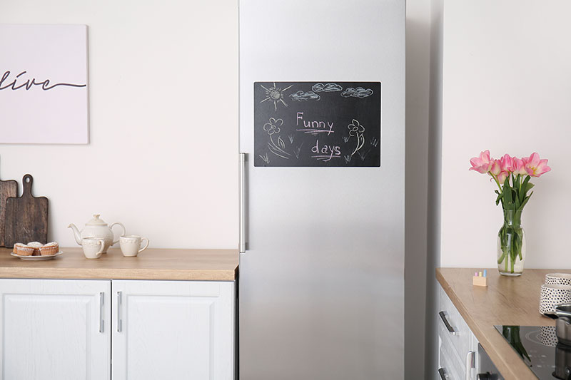 Fridge In the corner of a Kitchen