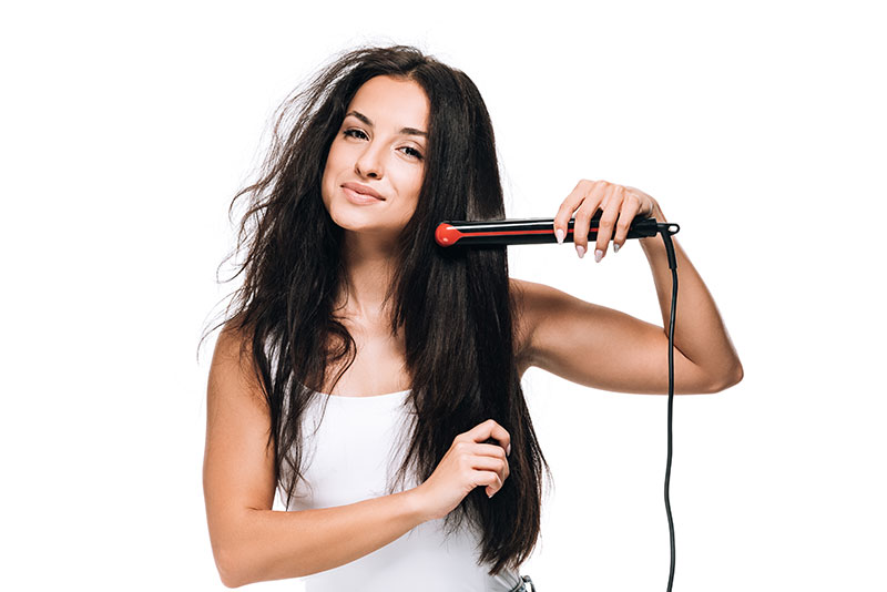 Woman-with-frizzy-hair-and-straighteners