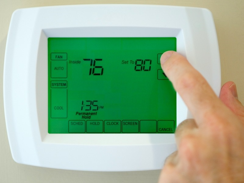 An air conditioner thermostat.
