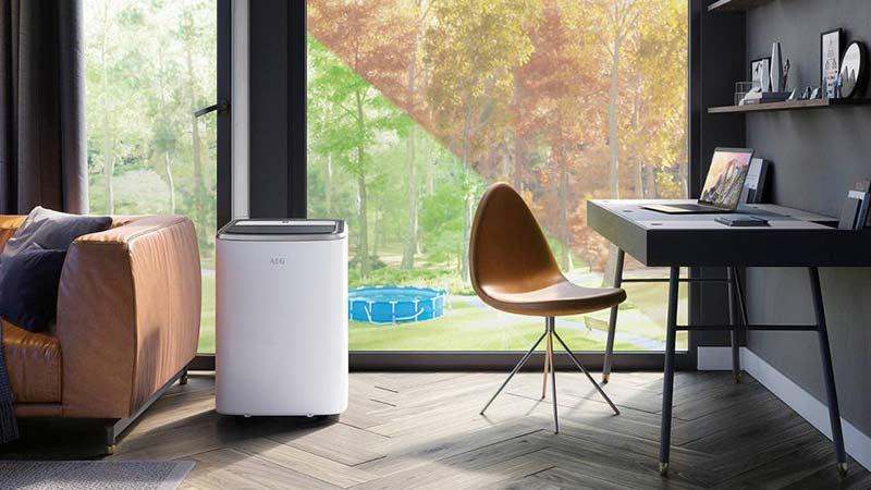 Portable air conditioner near a door