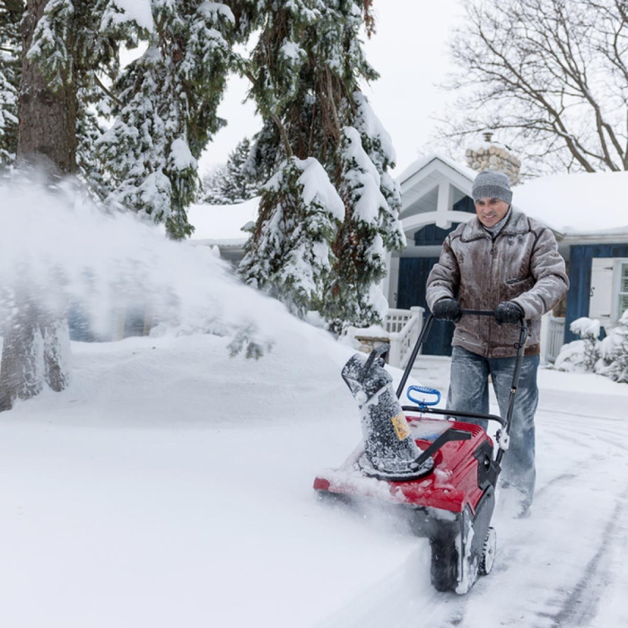 Man using snow blower