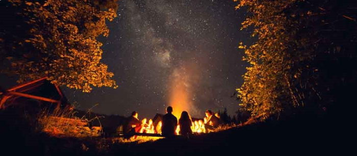 Camping under night sky