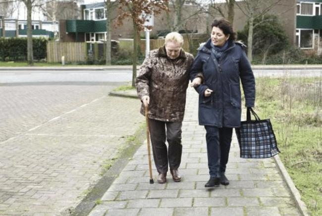 Two female walking on a side walk