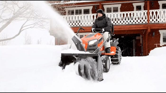 man sitting on a snow blower
