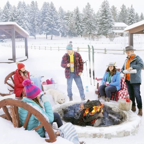 Family and friends gathered around a fire pit