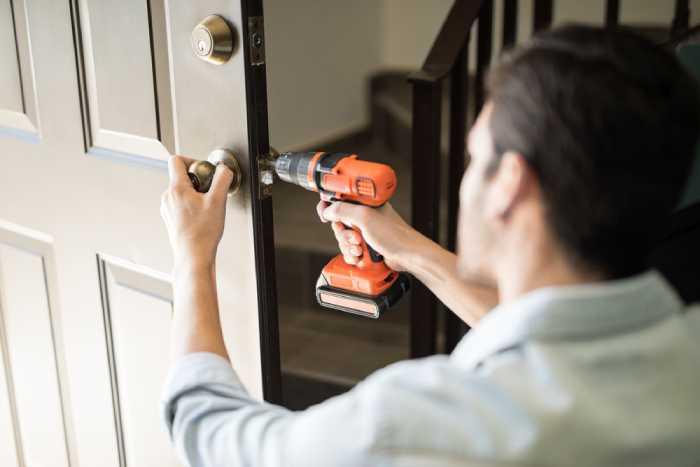 man fixing a door