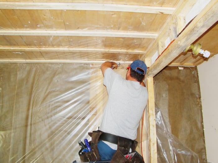 man installing vapor barrier