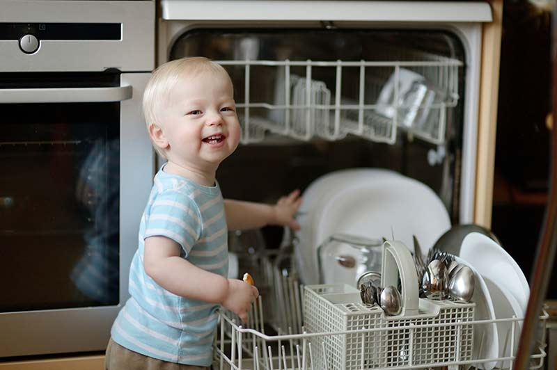 Child in front of dishwasher