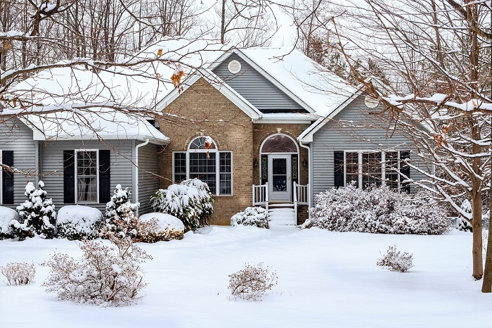 Vinyl siding on home in winter