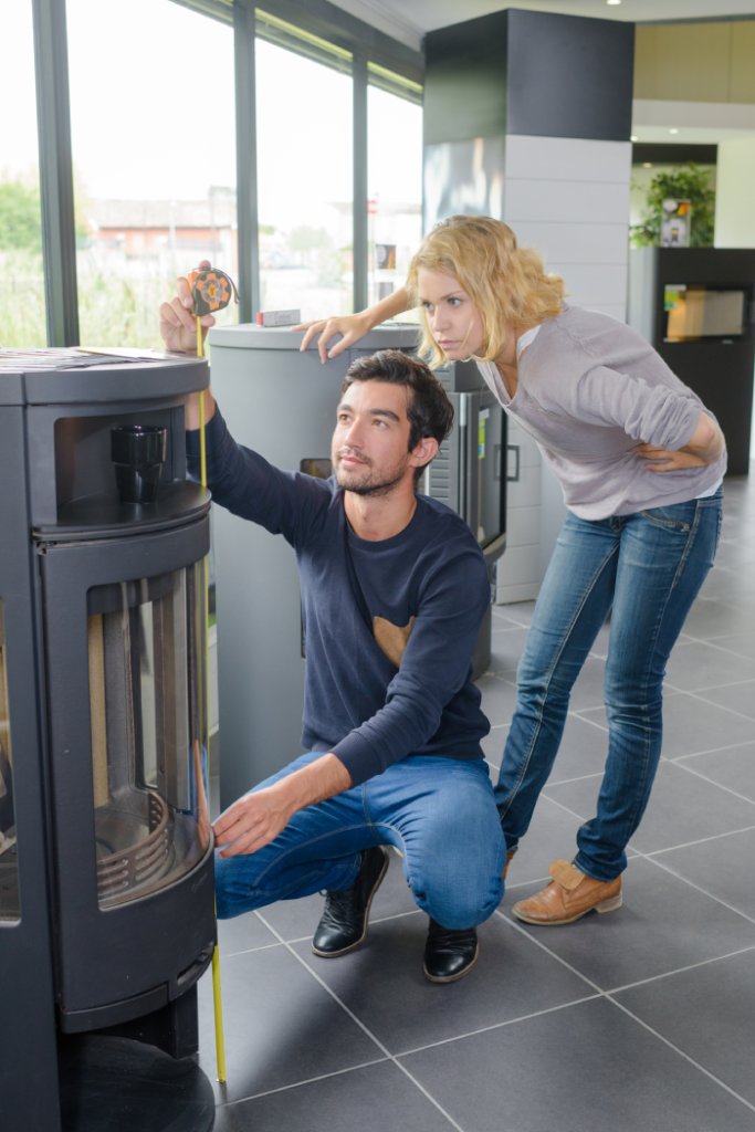 woman and man checking furnaces