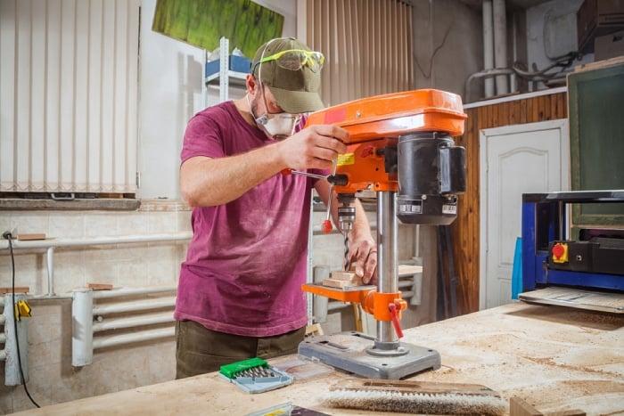 man using bench press drill