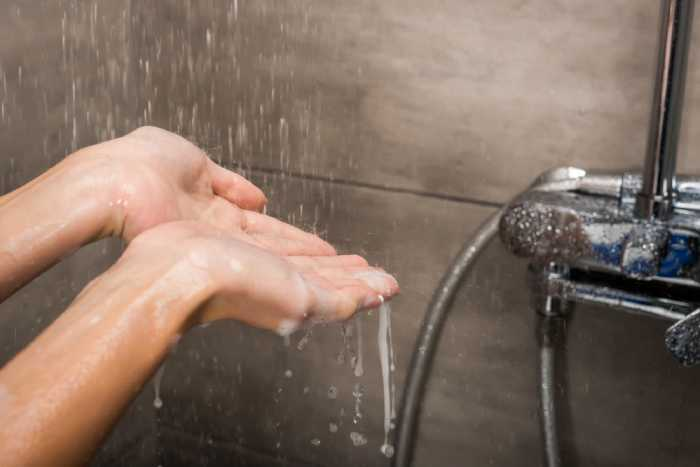 water running down on hands
