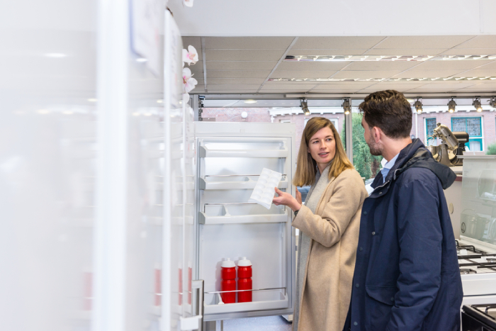 woman and man checking refrigerator