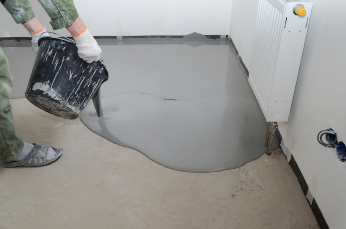 pouring self-levelling concrete from the corner