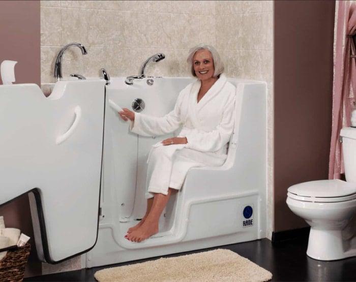 Walk-in bathtub with a female elderly.