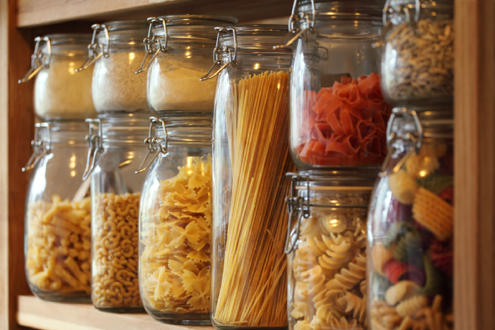 storage jar with different kinds of pasta