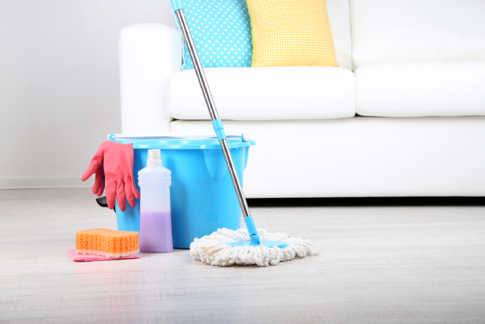Water bucket, cleaning solution and traditional mop on floor