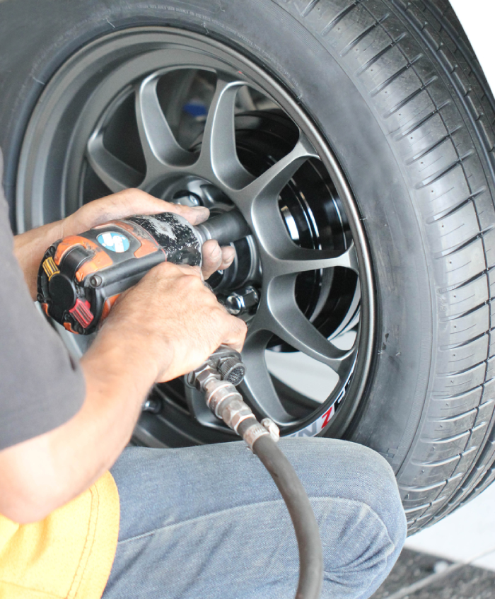 man holding a corded impact wrench