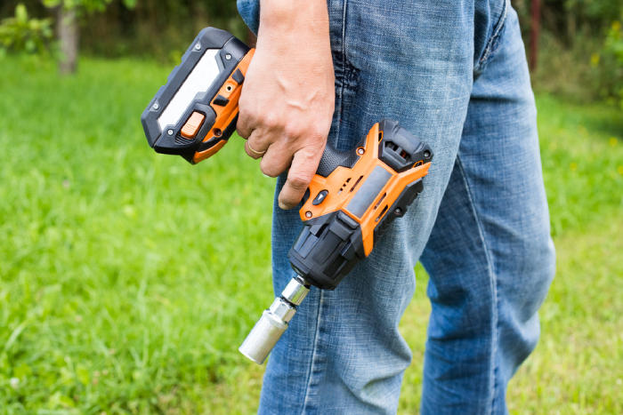 man holding a cordless impact wrench