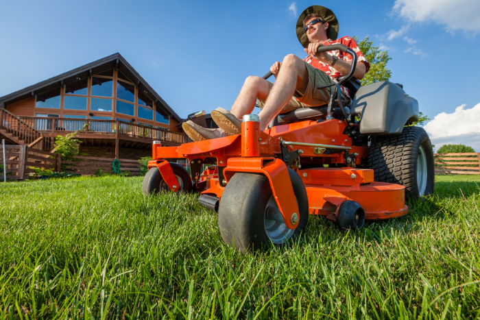male sitting on a lawn tractor