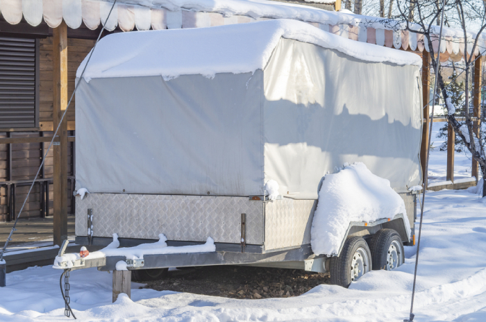Covered and parked RV in winter