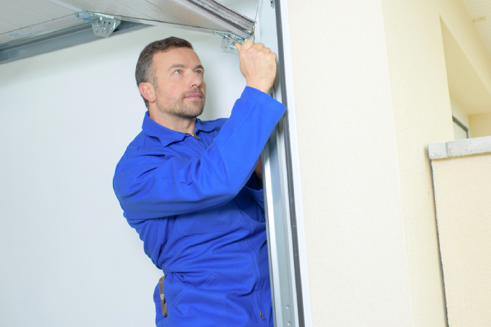 male checking garage door
