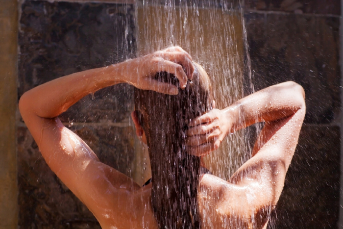 female taking a shower
