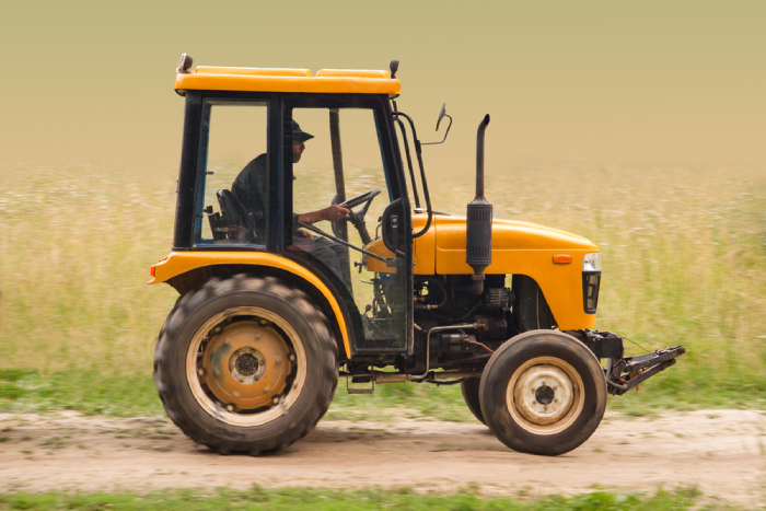 male driving a garden tractor