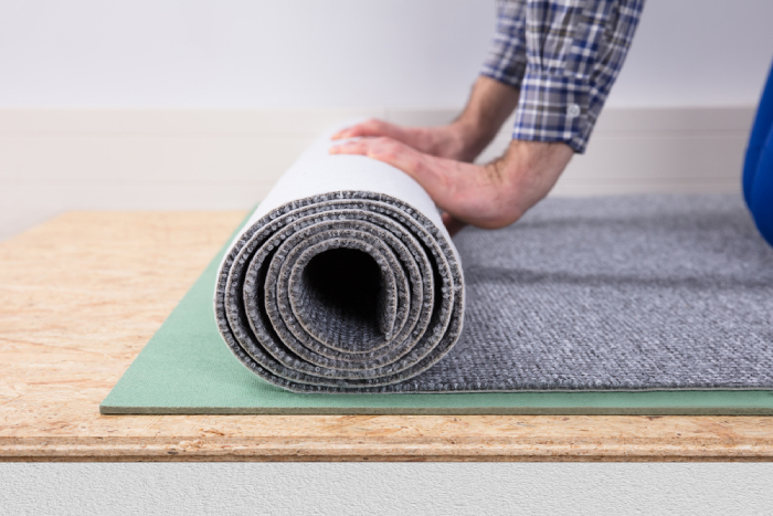 male rolling carpet