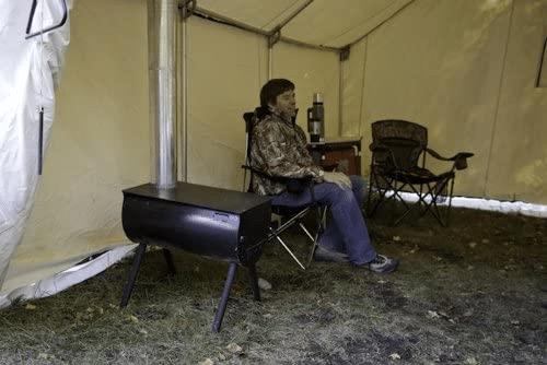male sitting inside tent