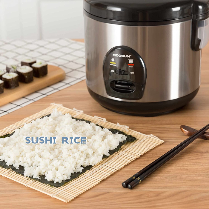 rice cooker and rice on a seaweed roll