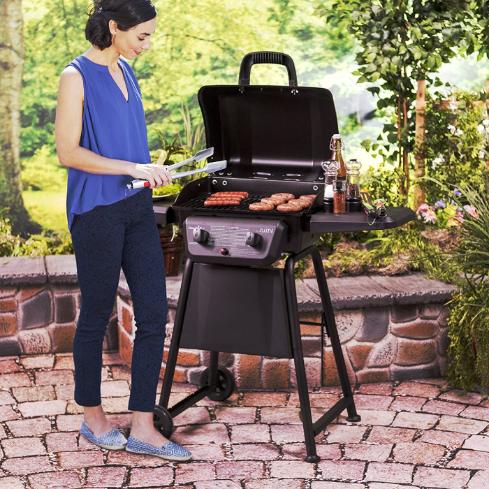 Female cooking on the grill