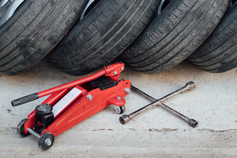 Car jack and tires