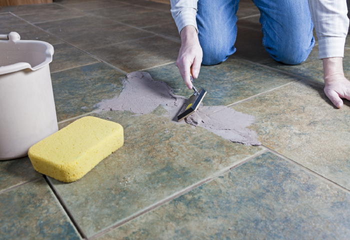 male using epoxy grout for floor tiles