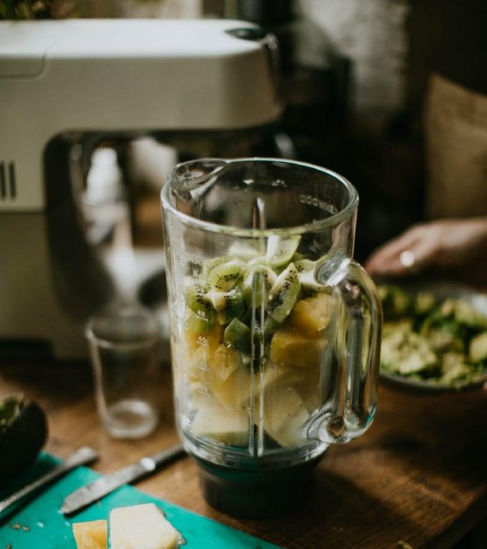 blender with fruits inside