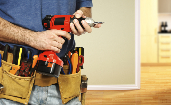 male with tool belt and hand drill