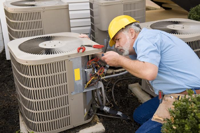 male checking HVAC unit